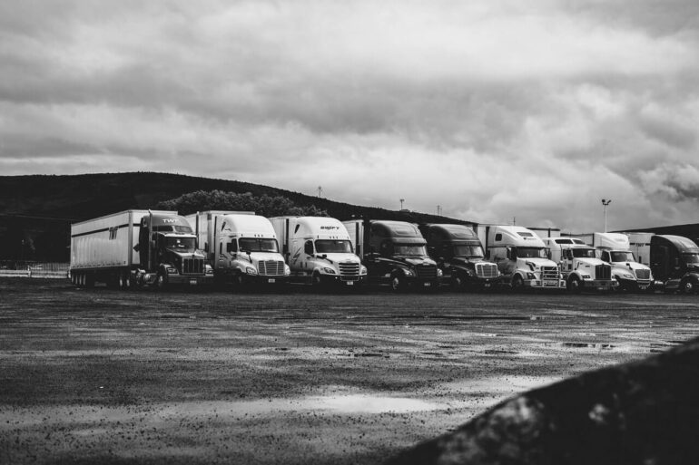 Safe truck terminal with a line of parked semi trucks