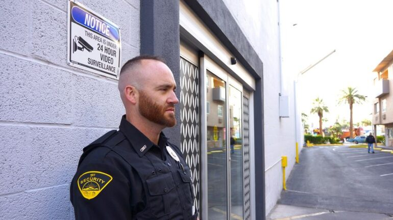 unarmed security guard on duty outside a post