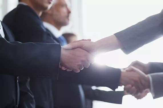 People shaking hands in a meeting
