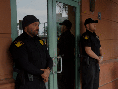armed security guards standing outside of building